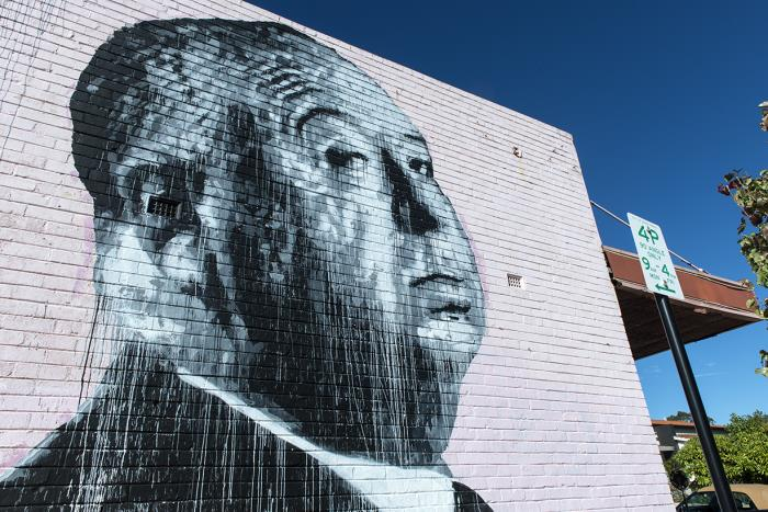 Photo of mural of Alfred Hitchcock on a white wall