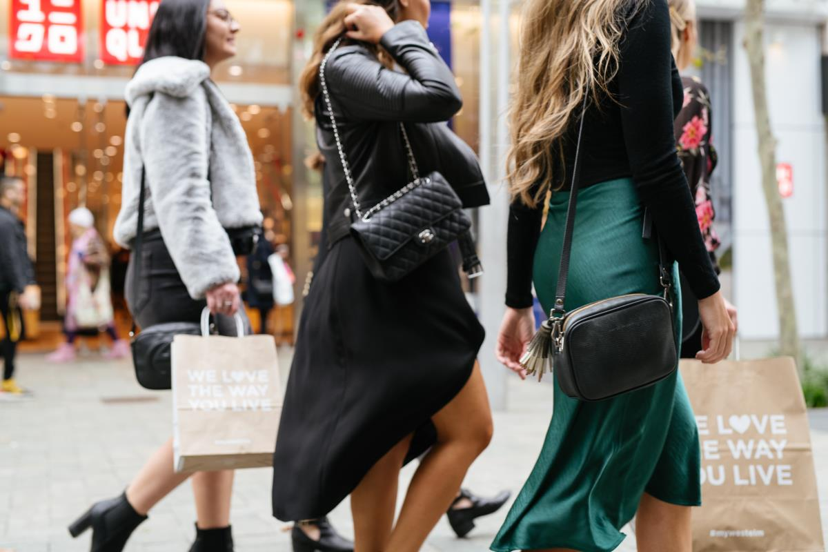 Three girls with shopping bags and handbags