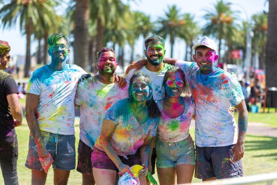 six people covered in colours from the Holi Festival